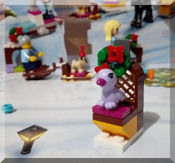 Lego bird on a fancy stand
