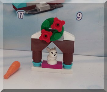 Lego rabbit sitting in a mantelpiece structure
