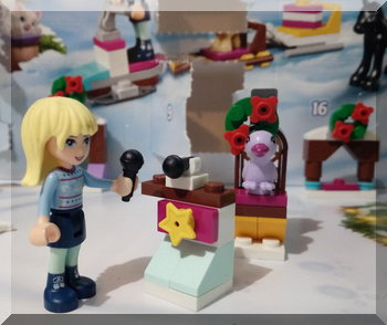 Lego Stephanie at a microphone stand