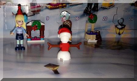 Lego snowman dressed as Santa