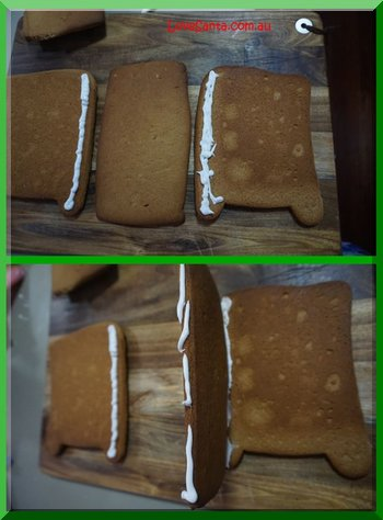 Sticking pieces of gingerbread together to form Santa's sleigh