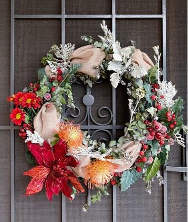 Red, orange and beige Christmas wreath on a door