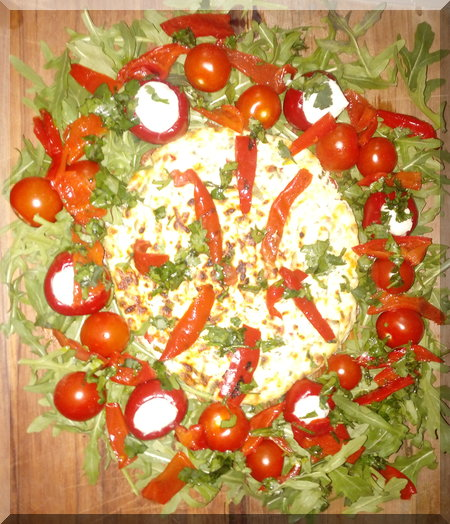 Baked cheese Christmas wreath on a wooden board