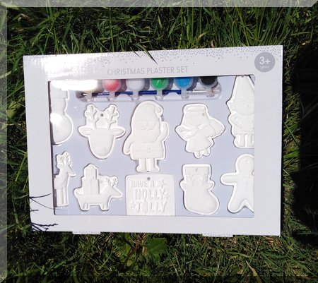 box of plaster ornaments, unpainted
