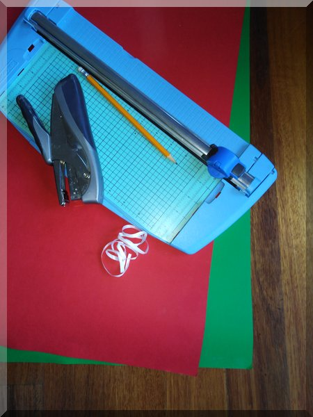 cardboard, ruler, pencil, stapler and scissor to make a Christmas decoration