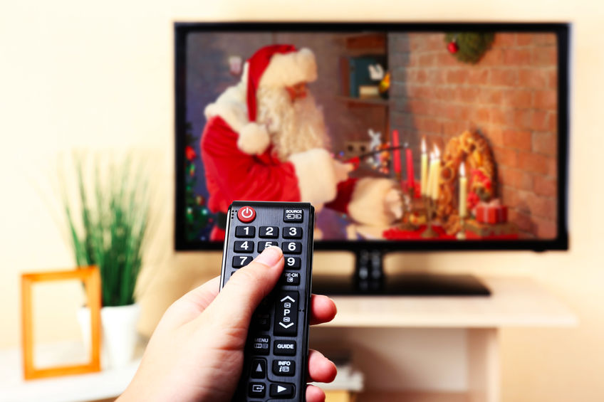 Santa in Christmas movie on a TV