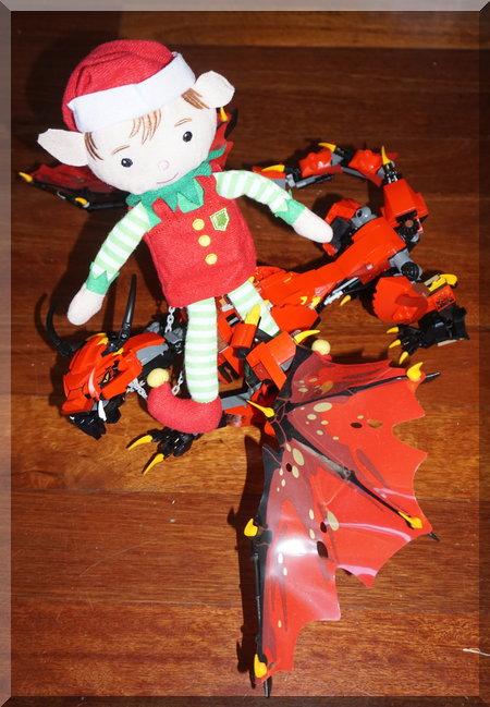 Elf sitting on a red Lego Ninjago dragon