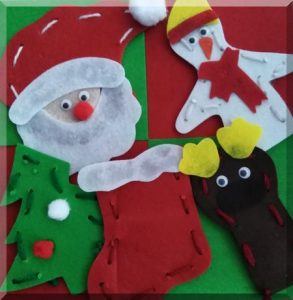 five felt Christmas finger puppets on a red and green background
