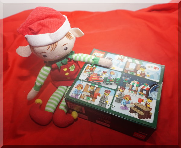 Tinkles the elf with a Lego train set box