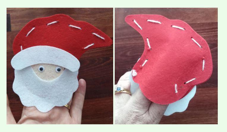 Santa finger puppet on adult fingers