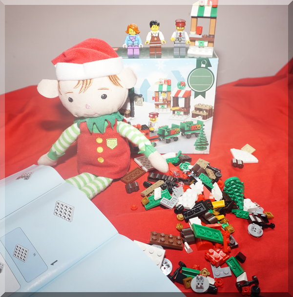 Tinkles the elf with Lego instructions and pieces