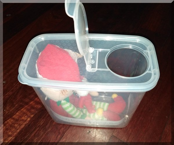 elves in a container with a pouring section of the lid open