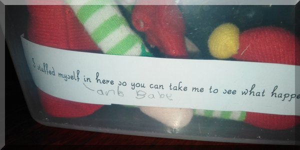 """Tinkles' note says """"I stuffed myself and baby in here so you can take me to see what happens at Mim's house this year!"""""""