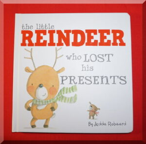 Front cover of a board book called The little reindeer who lost his presents
