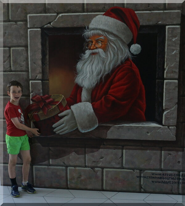 Santa handing a gift to a boy through a window