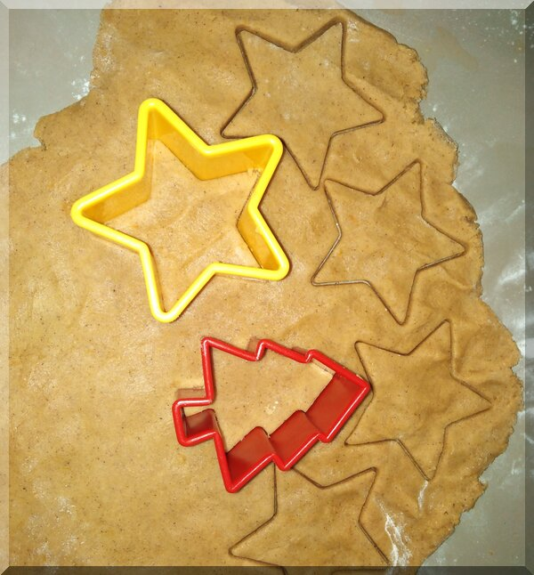 Pepparkakor dough being cut into Christmas shapes