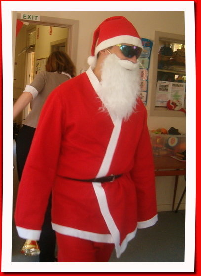 Man dressed as Santa on a hot day