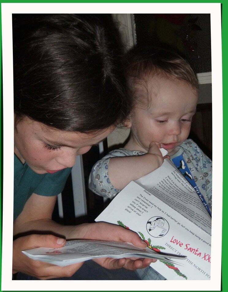 Girl eading Love Santa letter to baby