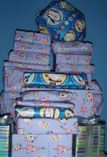 Pile of Christmas gifts in purple and silver bows