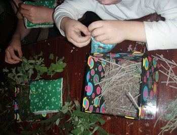 children stuffing sachets as gifts