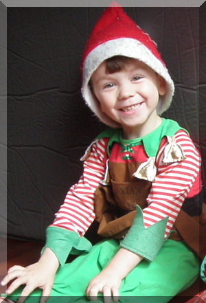 Boy in Christmas elf costume