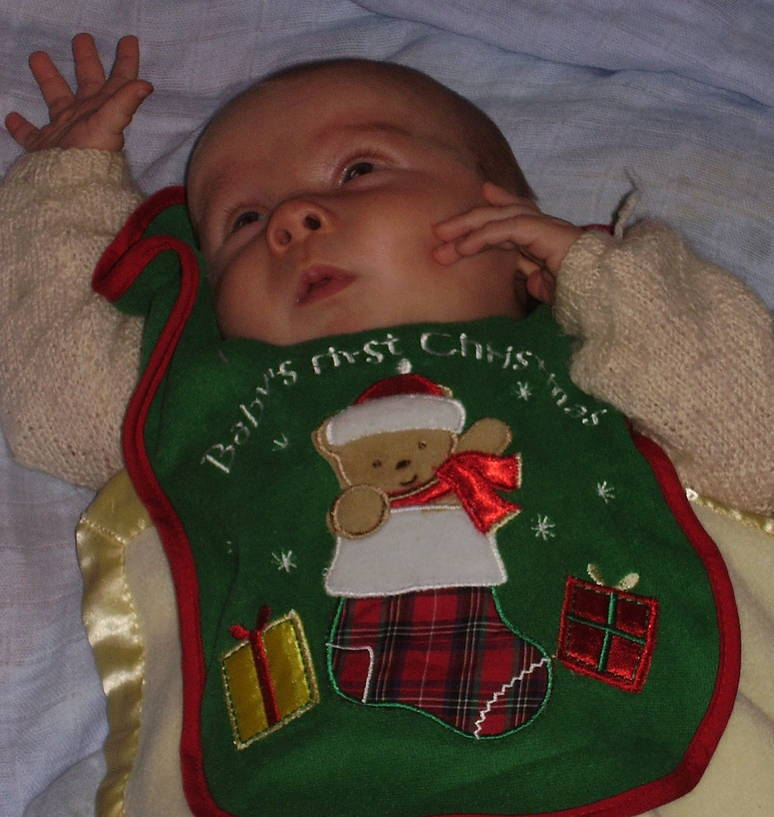 Baby in a first Christmas bib