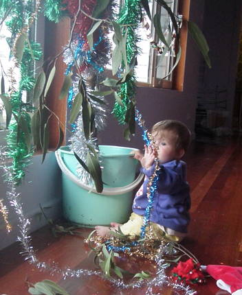 Baby playing with Christmas Gumtree tinsel