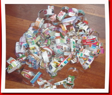 Pile of paper chains made from cut up junk mail