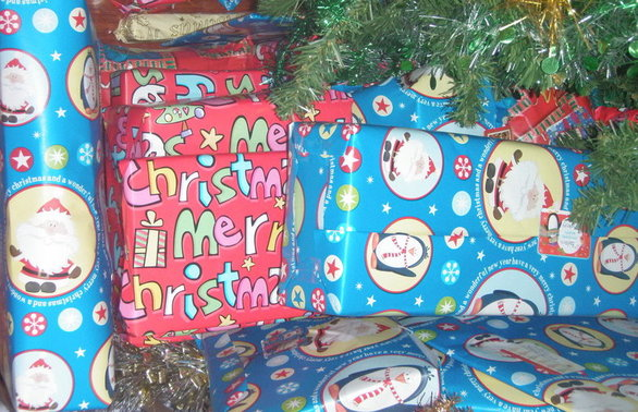 pile of Christmas wrapped gifts