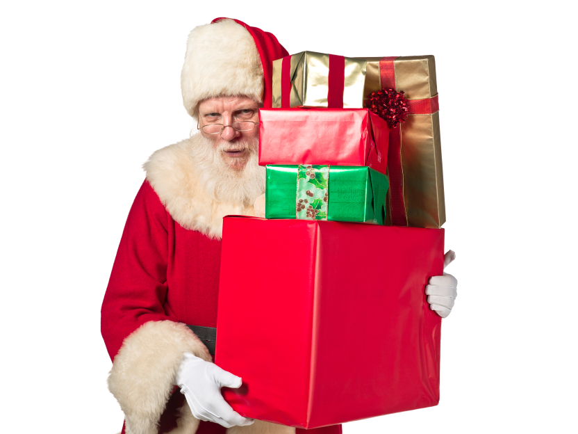 Santa holding a pile of presents