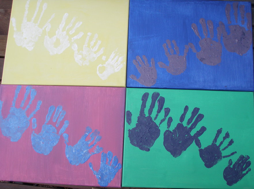 Four paintings made of children's hand prints