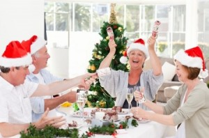 Family celebrating Christmas together with a meal and bon bons