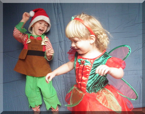 Children dressed as Santa's helper and Christmas fairy dancing