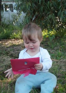 baby girl holding a red envelope