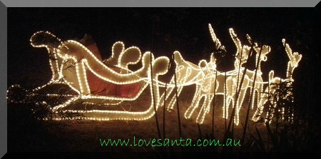 A light display of a sleigh and reindeer