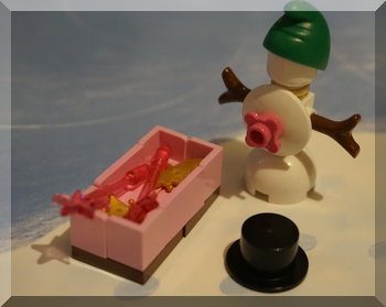 SNowman wearing elf hat near wands and crowns