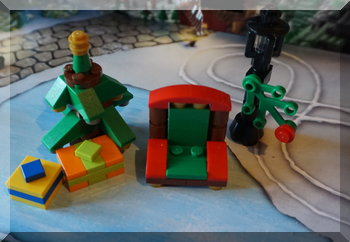 Lego presents udner a Christmas tree beside Santa's chair