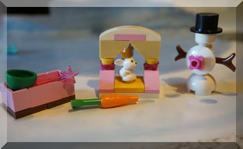 Lego bunny in shelter with a snowman