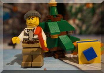 Lego robber beside Christmas tree