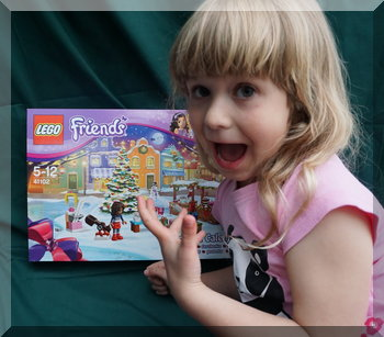 Little girl excited to get Lego Friends advent calendar