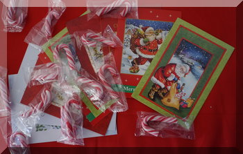 CHristmas cards and candy canes across a table