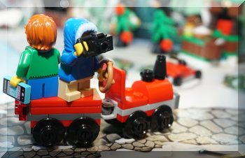 Lego people standing on a train carriage from the advent calendar