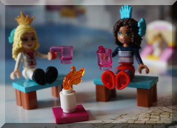 Lego girls sitting on benches with mugs