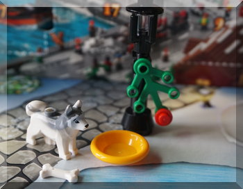 Lego husky with a dirnking bowl under a street lamp