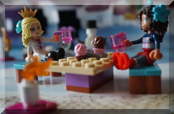 Lego girls sitting at a table