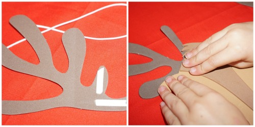 Image fo reindeer antlers with adhesive and then being atatched to the mask