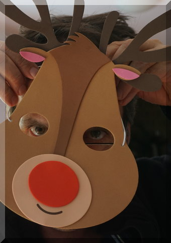 A close up on the reindeer mask over a face
