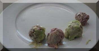 Four chocolate Christmas trolls on a plate