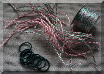 green hair ties and Christmas ribbon cut into strips