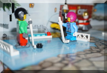 Two Lego characters ready for ice-hocket